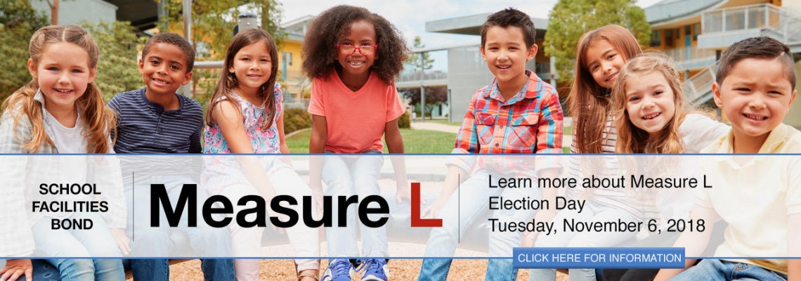 Measure L Banner with students on playground